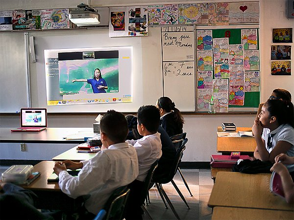 Students in a classroom watching Aquarium led video conference